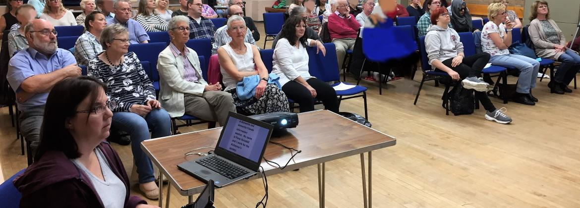audience at a Saturday Forum